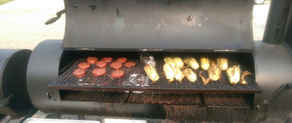smoking ribs, hamburgers, and corn on the cob